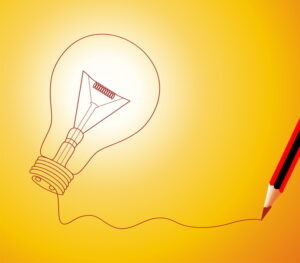 drawing-of-a-lightbulb-on-yellow-background