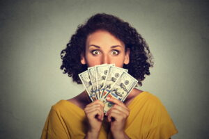 woman-holding-money-in-front-of-face